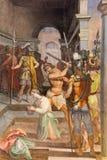 ROME ITALIEN - MARS 11, 2016: Freskomålningen av martyrskap av St Protasius i kyrkliga Basilika di San Vitale av Tarquinio Ligust Arkivfoton
