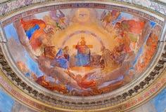 ROME ITALIEN - MARS 11, 2016: Freskomålningen Kristus i härlighet i kyrkliga Basilika di San Nicola i Carcere av Vincenzo Pasqual Royaltyfri Bild