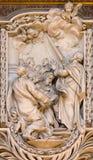 ROME ITALIEN - MARS 10, 2016: Lättnaden av platsen från liv av St Simon aposteln av Salvatore Bercari 18 cent Royaltyfria Bilder