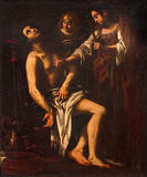 ROME ITALIEN - MARS 12, 2016: Målningen av död av St Sebastian i kyrkliga basilikadi Santi Quattro Coronati av Giovanni Bagl Royaltyfria Bilder