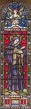 ROME ITALIEN - MARS 9 2016: Sten Beda Venerabilis på för helgon` för målat glass allra den anglikanska kyrkan Arkivbilder