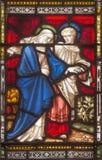 ROME ITALIEN: St John och jungfruliga Mary på helgonens för fönsterruta allra anglikanska kyrka Royaltyfri Bild