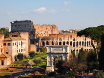 Rome, Italy. Colosseum and Arch, view from Roman Forum Royalty Free Stock Photo