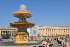 Rome, Italy. 28 March, 2012: Architectural detail of splashing fountain in San Pietro (San Peter) square in Vatican, Rome stock photo