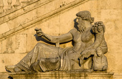 Rome, Italy. Renaissance sculpture of the man holding the Cornucopia Stock Images