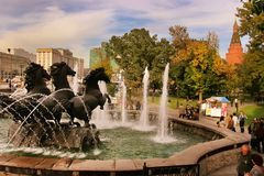 MOSCOW, RUSSIA - September 18, 2017: Fountain Four seasons at the Manege square in Moscow. Cityscape of Manezhnaya square in city. Center of Moscow, Russia royalty free stock photography