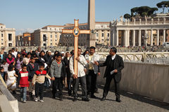 Rome, Italy - APRIL 10, 2016: Groupe of pilgrims going to St Pet Stock Photos