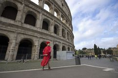 Rome / Italy - April 23 - 2015 : A man with gladiator clothes standing in front of Colloseum. A man with gladiator clothes holding a sword is standing near to royalty free stock photography