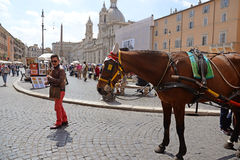 ROME, ITALY - APRIL 18, 2015: A man with horse in Piazza Navona, famous place in Rome. Italy Royalty Free Stock Images