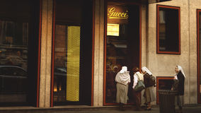 Rome, Italy, on April 23, 2014. Nuns and Gucci's shop. Stock Photography