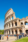 ROME, ITALY - APRIL 24, 2017. Outside view of The Colosseum with tourists waiting to enter Royalty Free Stock Photo