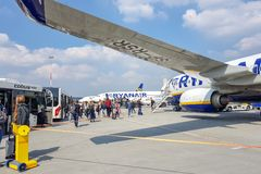 ROME, ITALY - APRIL 09, 2019: Passengers get out of the aircraft Rainer and sit on buses at the airport royalty free stock photo