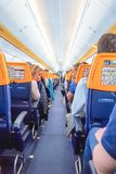 ROME, ITALY - APRIL 09, 2019: People on the board of Ryanair Plane stock photo