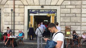 Customers queuing to enter the famous Sant`Eustachio bar in Rome stock video