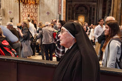 Rome, Italy - APRIL 10, 2016: Thousands of nuns and priests are. Visiting St. Peter's Basilica in the Vatican every year as pilgrims Stock Photos