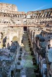 View of the center aisle inside the Colosseum in Rome. stock images