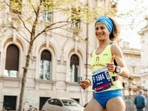 Woman runner run and smiles and shows thumb during Rome marathon. Rome, Italy - April 8, 2018: woman runner run and smiles and shows thumb during Rome marathon royalty free stock photos