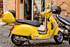 ROME, ITALY - APRIL, 30: Yellow retro Italian scooter Vespa on the street in Rome, April 30, 2013 Royalty Free Stock Image