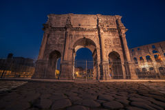 Rome, Italy: Arch of Constantine in the sunset. Colosseum, Flavian Amphitheatre in the background Stock Photography
