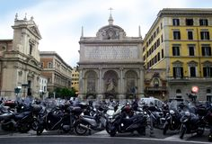 Rome Italy architecture Parking of motorcycles and scooters Catholicism temple. Rome capital of world tourism sculpture architecture and fountains Catholic royalty free stock photo
