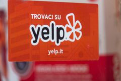 Yelp company symbol. Rome, Italy - August 10, 2018: Banner of the Yelp company, a local-search service powered by crowd-sourced review forum run by an American royalty free stock photos