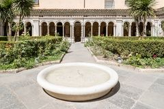 Cloister of the Papal Basilica of St. Paul outside the Walls. Rome, Italy - August 21, 2016: Cloister of the Papal Basilica of St. Paul outside the Walls . It is stock image