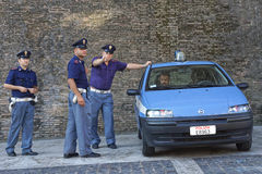 ROME-ITALY, AUGUST 28, Italian police on duty at the walls of th. E Vatican in Rome August 28, 2013. Servant of the law expresses dissatisfaction with the photo royalty free stock image