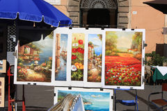 Piazza Navona. ROME, ITALY - AUGUST 2: Paintings at Piazza Navona on August 2, 2012 in Rome, Italy.  Piazza Navona is a famous tourist destination in Rome Royalty Free Stock Photo