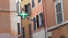ROME - ITALY, AUGUST 2015: pharmacy shop sign and woman stock footage
