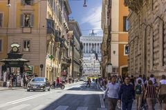 Roman Street Via del Corso and Altar of the Fatherland on the background stock photography