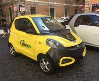 Electric car hire. Rome, Italy - August 08 2017: A Share N Go Electric car parked on a cobbled street in the City centre royalty free stock photos