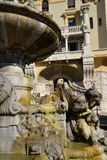 Rome, Italy, baroque water fountain and liberty building Stock Images