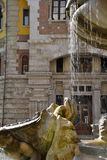 Rome, Italy, baroque water fountain and liberty building Royalty Free Stock Photography