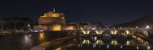 Rome Italy. Beautiful view of Castel Sant`Angelo and the bridge at night with reflections on the Tiber river.  royalty free stock photo