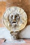 Rome, Italy - Bocca della Verita. Rome, Italy. The Mouth of Truth (La Bocca della Verita) carved from Pavonazzo marble, in the portico of the church of Santa Royalty Free Stock Images