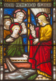 ROME, ITALY: Calling of the twelve apostles on the windowpane of All Saints' Anglican Church by workroom Clayton and Hall Stock Image