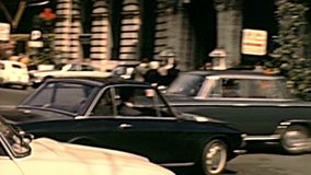 Horse carriage in Veneto street of Rome. ROME, ITALY - CIRCA 1970: The Italian cars in traffic of famous Vittorio Veneto street with horse carriage. The hotel stock video footage