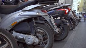 ROME, ITALY - CIRCA May 2018: Motorcycle parking in Rome. Motorbikes standing on street in Europe stock video footage
