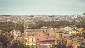 Rome, Italy: cityscape from above, vintage filter applied. Personal perspective of Rome, Italy, at dusk. Panoramic cityscape from above with old retro filter Stock Images