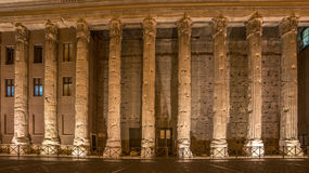 Rome, Italy: columns of Hadrians Temple in Piazza di Pietra. Rome, Italy: columns of Hadrians Temple, Temple of Neptune, in Piazza di Pietra at night Stock Photography