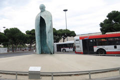 Rome, Italy. Conversazioni Pope John Paul II statue at Termini train station. A tall bronze sculpture, with a clock in the place of a body, dedicated to Pope royalty free stock image