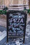 Bistrot Menu. ROME, ITALY - DECEMBER 30, 2017: Chalkboard with menu of the famous roman bistrot Gia Roma inviting to taste delicious traditional italian meals Stock Images
