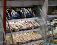 Grana Padano cheese. Rome, Italy - December 22, 2017: Grana Padano cheese in Eataly shop. Grana Padano is a hard, slow-ripened, semi-fat cheese from Italy Royalty Free Stock Photography
