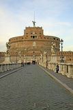 ROME, ITALY - DECEMBER 20, 2012: People on the bridge of Castel Sant'Angelo in Rome, Italy Stock Photo