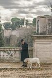 Senior Man and Dog at Villa Borghese Park, Rome, Italy