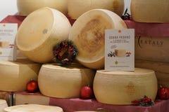 Wheels of Grana Padano cheese. Rome, Italy - December 22, 2017: wheels of Grana Padano cheese in Eataly shop. Grana Padano is a hard, slow-ripened, semi-fat Royalty Free Stock Photo