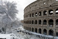 Snow covers the streets of Rome, Italy. Piazza del Colosseo come royalty free stock photo