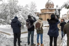 Snow covers the streets of Rome, Italy. Statue of Giulio Cesare. Rome, Italy - February 26, 2018: An exceptional weather event causes a cold and cold air across stock photo