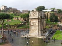 View of the Arch of Constantine in rainy day in Rome, Italy. Rome, Italy - February 2, 2018: View of the Arch of Constantine in rainy day from Colosseum in Rome Stock Photography
