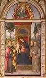 ROME, ITALY: Fresco Madonna with the child and saints in Basso della Rovere chapel in church Basilica di Santa Maria del Popolo. Stock Images